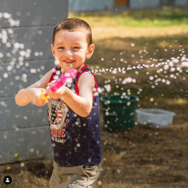 community photo of a boy playing with a watergun from vancouver, washington's instagram as an example of government instagram accounts to follow