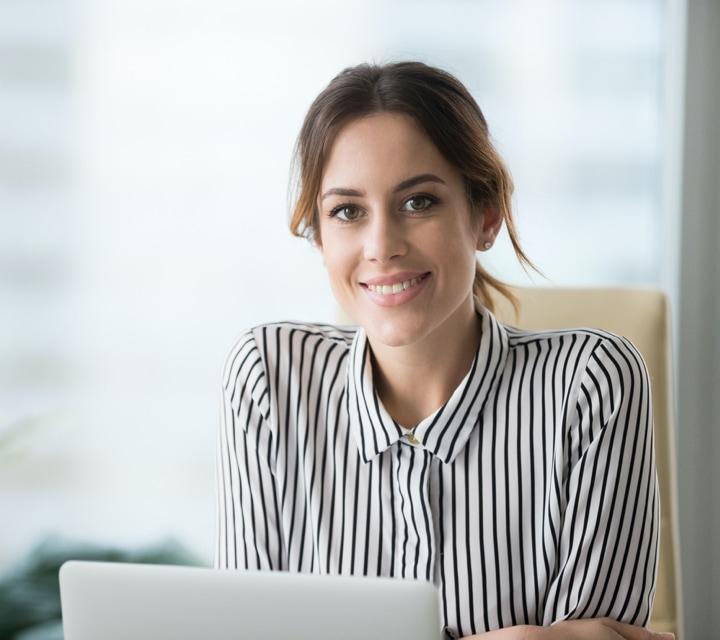 smiling woman at desk