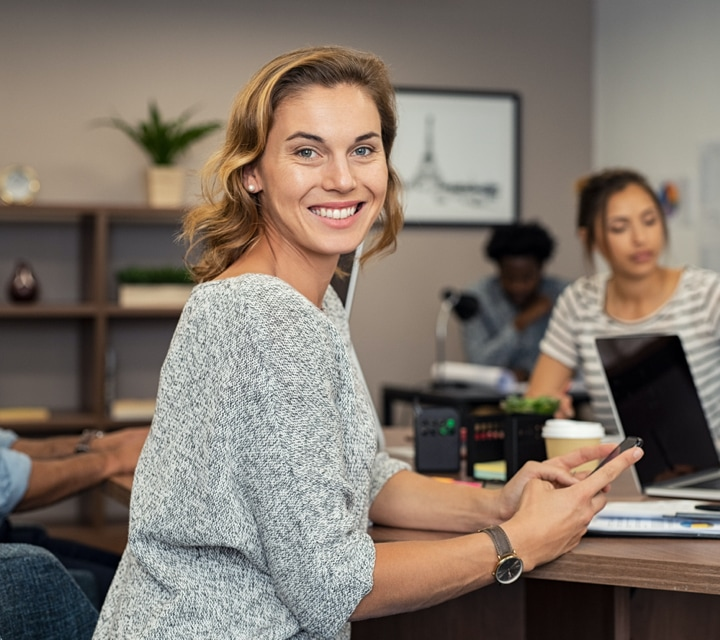 woman smiling and working in an office